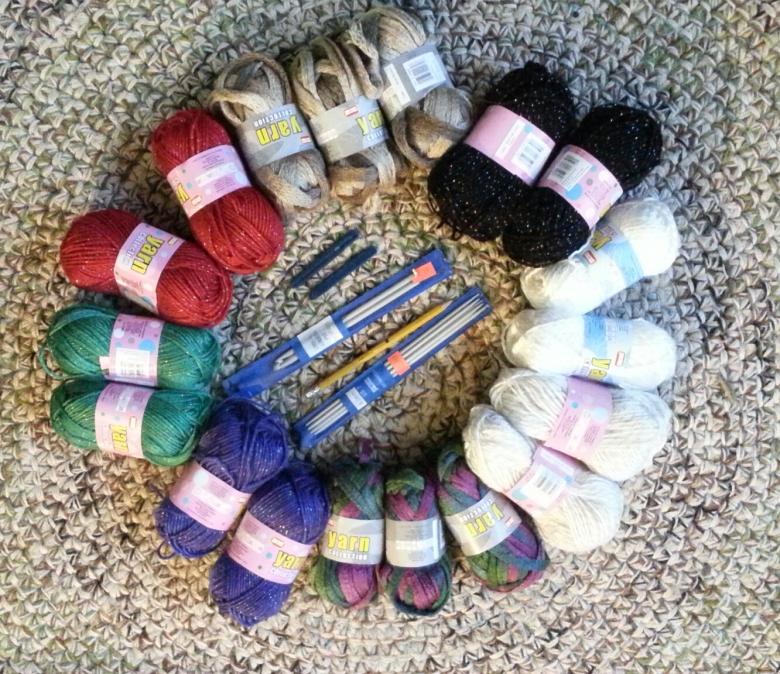 Balls of wook, knitting needles, and crochet hooks