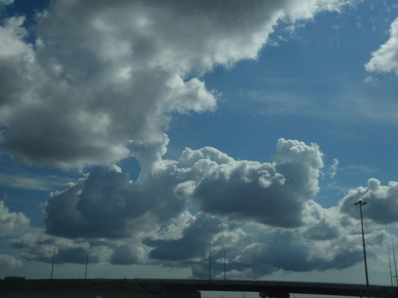 Puffy clouds in a blue sky
