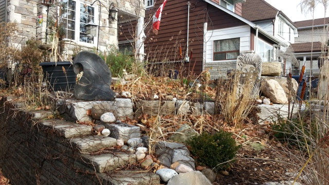house decorated by rocks and stone sculpture