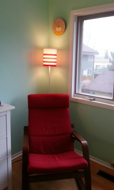 A peaceful room with a lamp and an easy chair