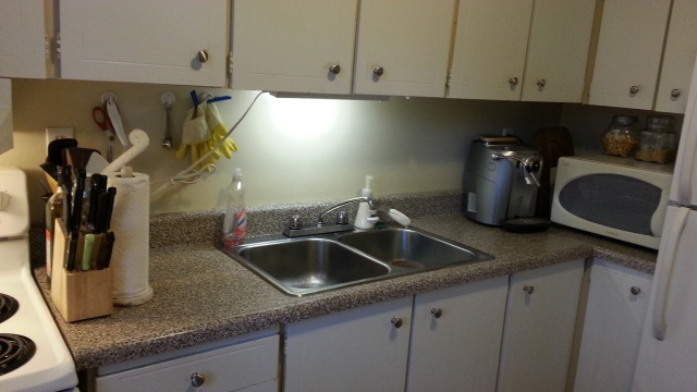 A clean kitchen counter, with coffee maker and microwave oven