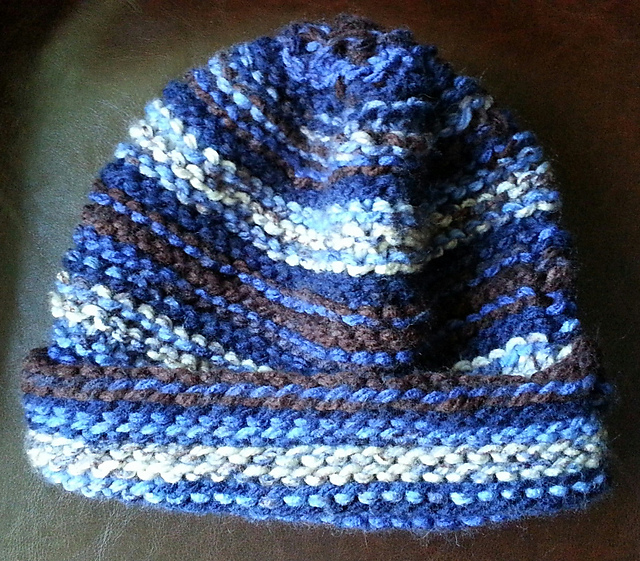 a knit hat with bands of blue, brown, and grey